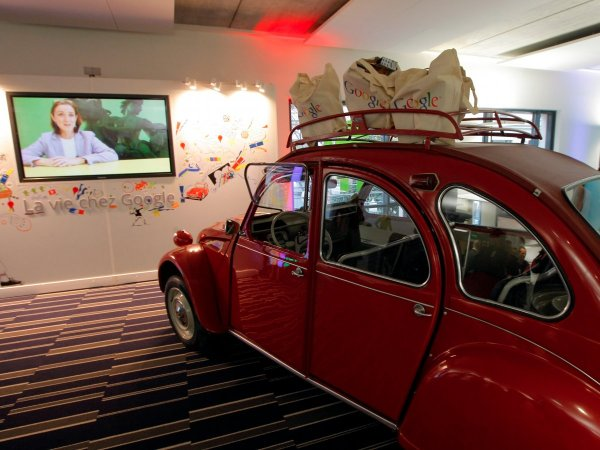 the-paris-office-has-a-shiny-red-citroen-2cv-car-inside