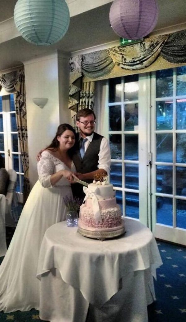 millie-and-matt-maltby-cutting-their-wedding-cake-at-berry-head-hotel-on-saturday-2