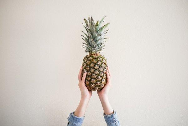 fresh-ananaspineapple-in-female-hands-picjumbo-com
