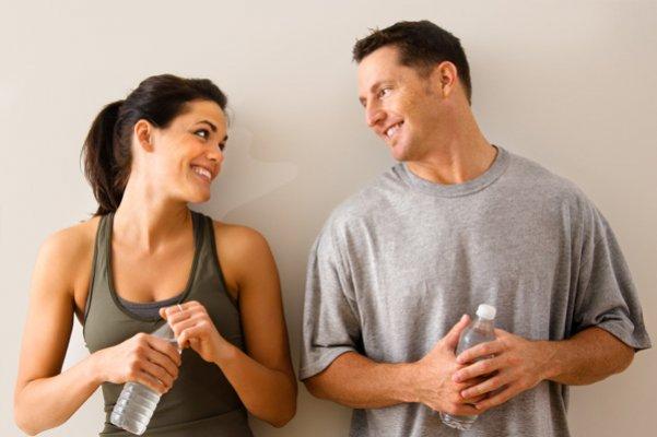 man-woman-flirting-gym