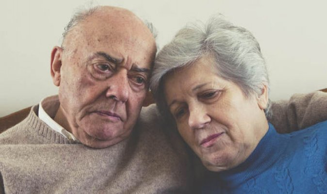 elderly-couple-looking-sad-586005