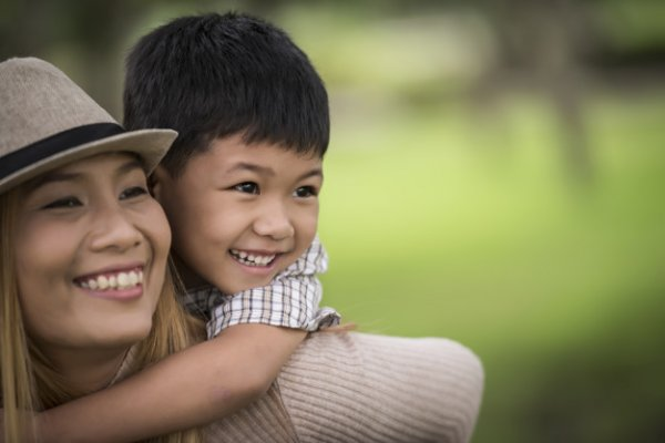happy-young-mother-son-laughing-little-boy-getting-piggyback-ride-her-back-1150-4767