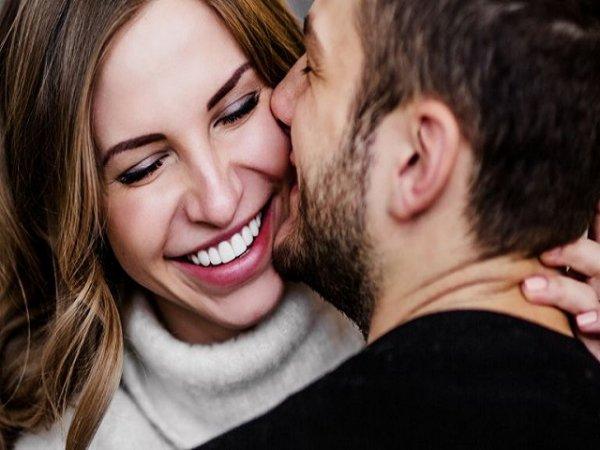 man-kissing-smiling-woman-768