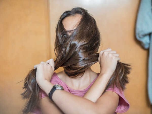 girl-covering-her-face-with-her-hair-732x549-thumbnail