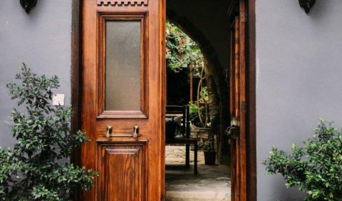 330235-opened-brown-wooden-french-door-1544420-f